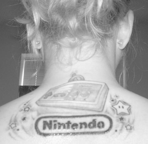 Is the first one a black and white tattoo?? I wonder…. funny nintendo tattoo
